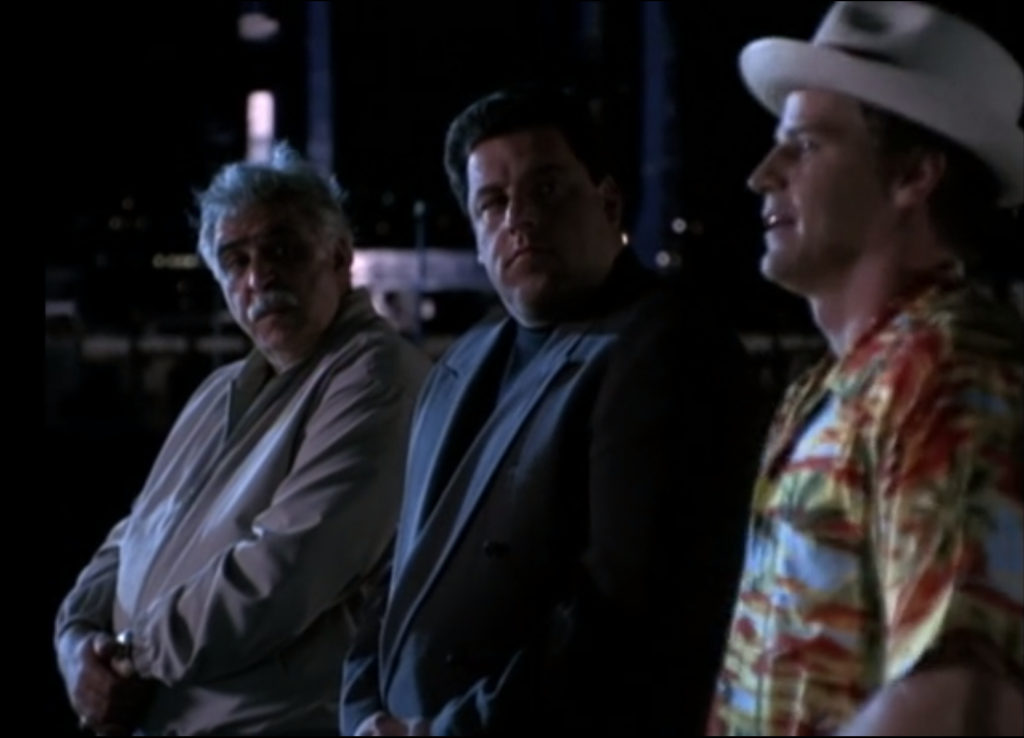 Angel is wearing Doyle's clothes, a stupid fedora and flowered short-sleeve button down.