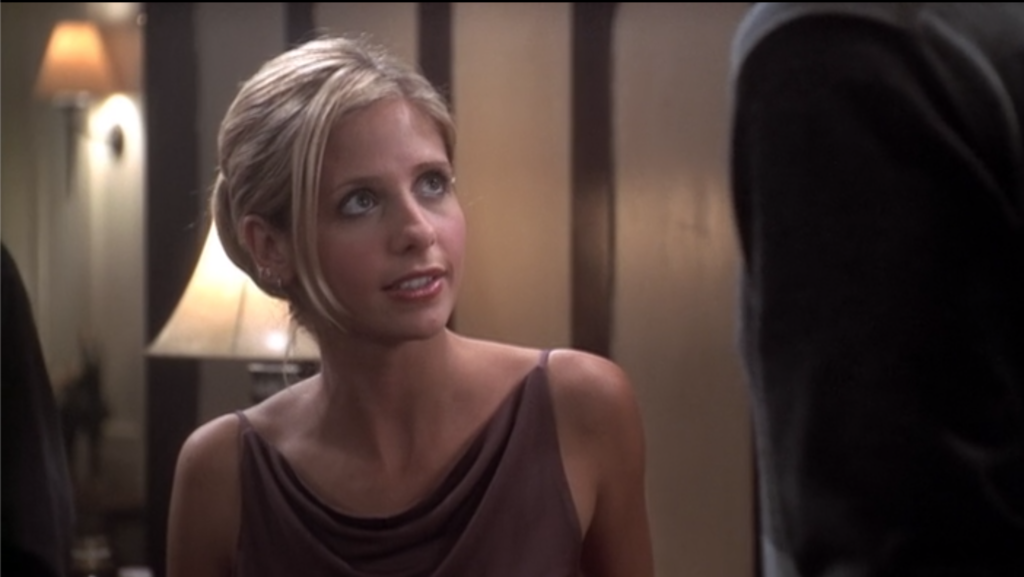 """Buffy's face is a cross between """"WTF is he talking about"""" and """"I have second hand embarrassment for myself having to watch this."""""""