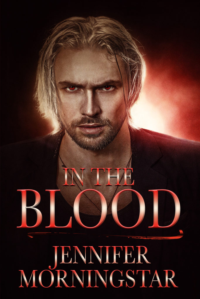 The cover for In The Blood. A good-looking dude with pale hair and red eyes on a red sorts of misty-ish background. The title is on it, right above the name Jennifer Morningstar