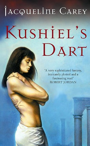 The cover of Kushiel's Dart shows a dark haired woman, topless and hugging herself. the background is a misty, far off ruined arch