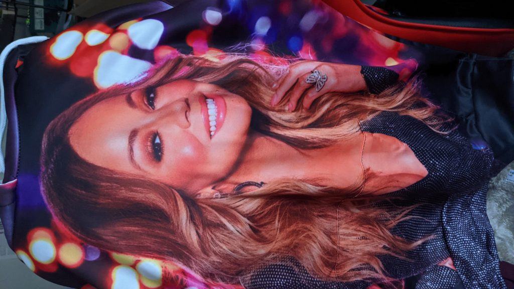 A hoodie draped over the back of my computer chair. It is printed with a huge image of Mariah Carey. As in, like a photo of Mariah Carey is the print of the entire fabric.